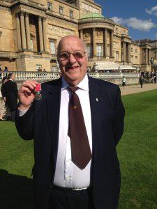 Tommy outside Buckingham Palace