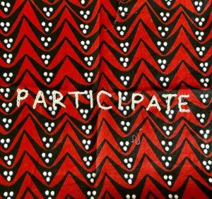 'Pariticipate' stitched onto a piece of fabric